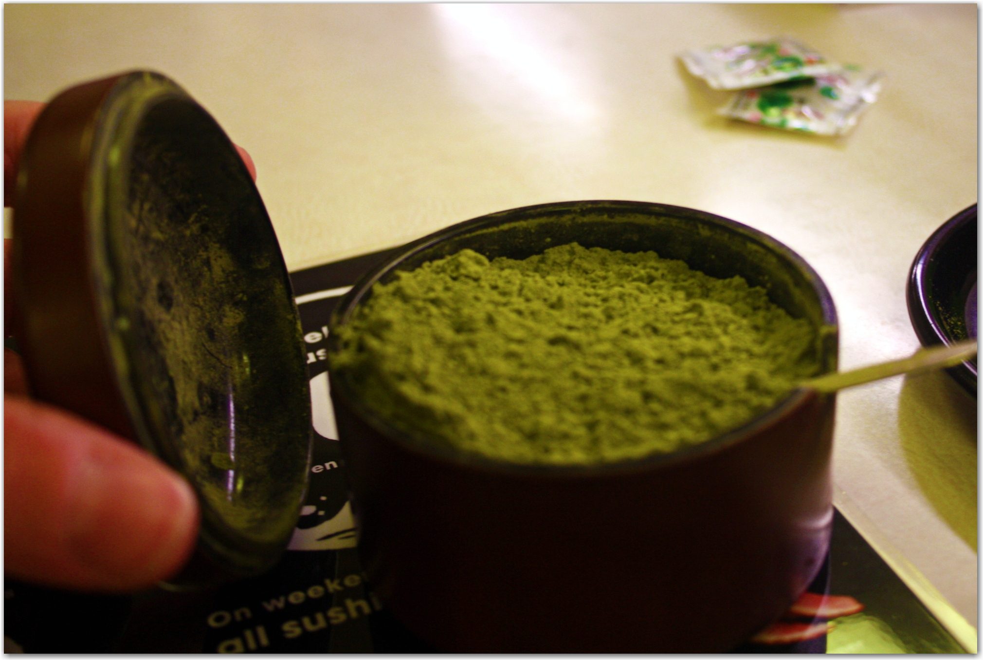 green tea powder at conveyor belt sushi